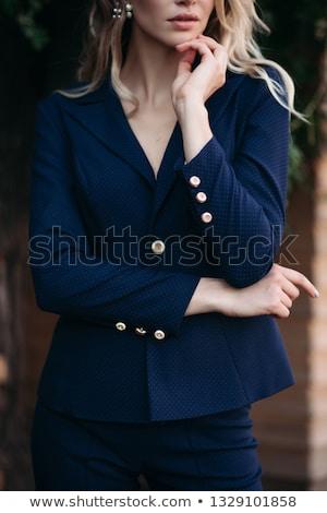 Elegante donna bionda buio blu suit oro Foto d'archivio © studiolucky