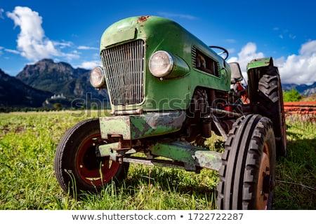 öreg traktor alpesi mezők tavasz munka Stock fotó © cookelma