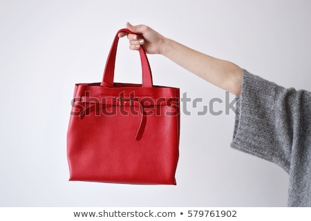 trendy woman with beautiful manicure holding red handbag stock photo © studiolucky