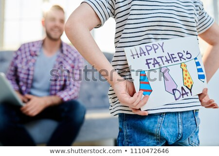 Hiding fathers day card behind back Stock photo © pressmaster