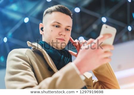 üzletember drótnélküli fülhallgató boldog fiatal visel Stock fotó © AndreyPopov