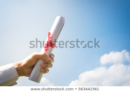 Hand holding Graduation certificate roll under the sunshine, blu stock photo © Freedomz