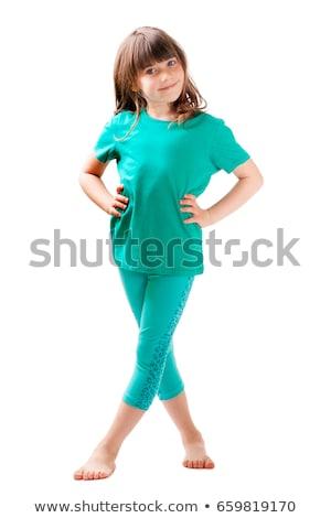 Pretty girl standing barefoot smiling Stock photo © nyul