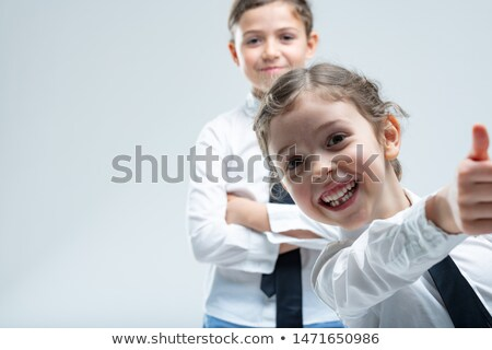 Cheeky enthusiastic little girl giving a thumbs up Stock photo © Giulio_Fornasar