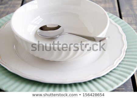 Empty bowl and silver spoon Stock photo © magraphics