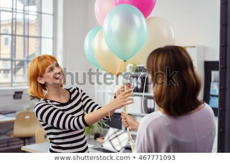 birthday party for the young female colleague in the modern offi stock photo © boggy