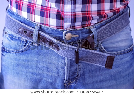 Man's Hand Unzipping His Blue Jeans Stock photo © AndreyPopov