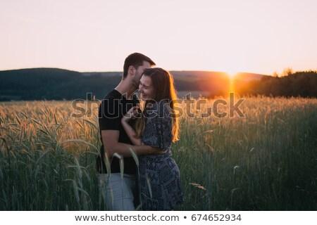 Feliz Pareja amor campo de trigo puesta de sol hombre Foto stock © dashapetrenko