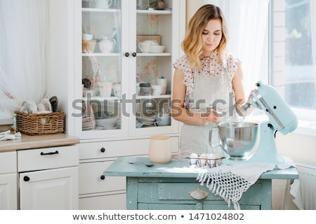 beautiful housewife preparing with kitchen mixer stock photo © vladacanon