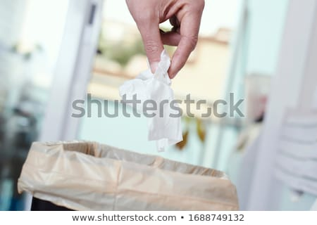 man throwing a used wet wipe to the trash bin Stock photo © nito