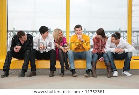 Grupo jóvenes sentarse puente peatonal vidrio belleza Foto stock © Paha_L