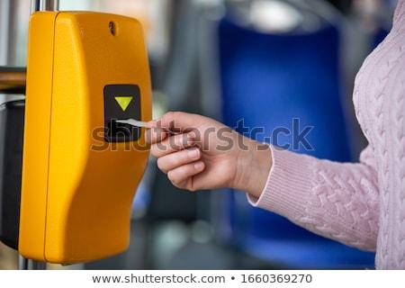 Man validating ticket on tram Stock photo © photography33