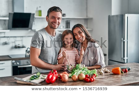 Family in their kitchen Stock photo © photography33