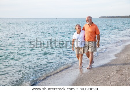 Elderly couple enjoying stroll on the beach Stock photo © photography33