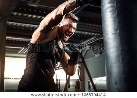 Fighter young man in training hall stock photo © pekour