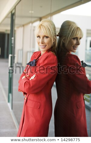 Pensive blond woman leaning on reflective surface Stock photo © photography33