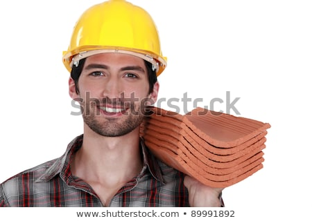 Stock photo: craftsman holding roof tiles