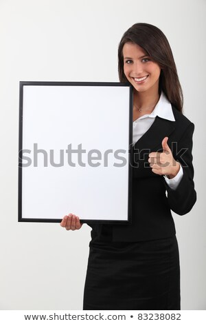 Attractive brunette stood with blank panel Stock photo © photography33