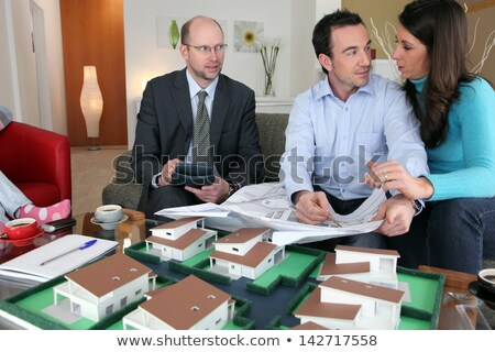 property salesman sat with couple stock photo © photography33