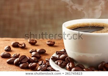 Beker koffie jute koffiebonen achtergrond cafe Stockfoto © elly_l