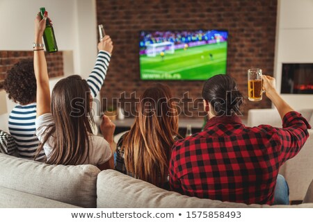 Friends enjoying a few drinks together Stock photo © photography33