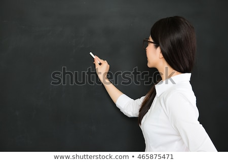 Woman with glasses writing on blackboard Stock photo © photography33