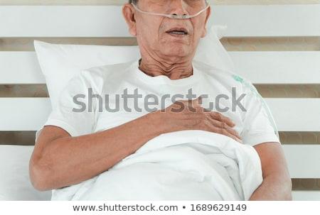 старший · женщину · кровать · сморкании · женщины - Сток-фото © wavebreak_media