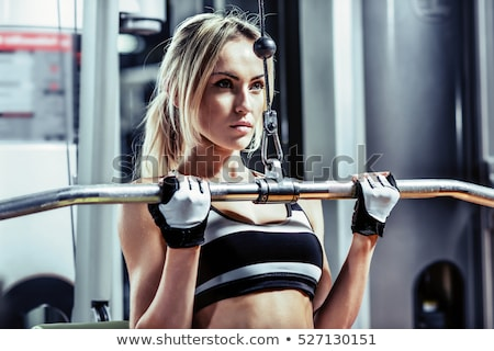 Fit slender woman working out stock photo © dash