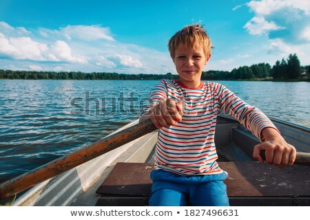 boy and boat stock photo © nailiaschwarz
