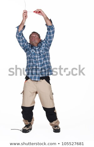 Man being electrocuted by ceiling cables Stock photo © photography33