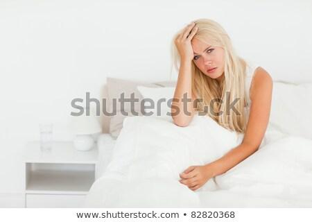 Zaklatott szőke nő felfelé kezek ágy fej Stock fotó © wavebreak_media