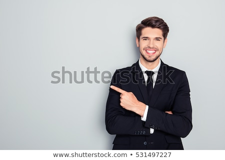 smiling business professional pointing away stock photo © stockyimages