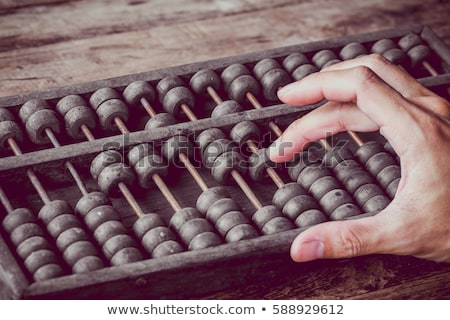 man with asian abacus Stock photo © compuinfoto