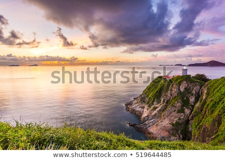 Foto stock: Puesta · de · sol · costa · Hong · Kong · rocas · agua · resumen
