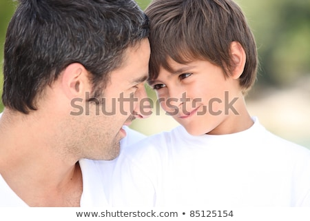 Father and son looking into each others eyes Stock photo © get4net
