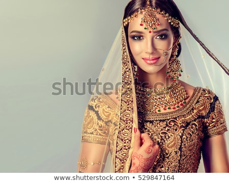 beautiful indian young brunette woman dancing stock photo © lunamarina