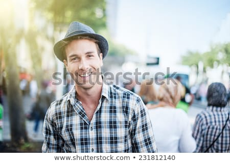 outdoor portrait of a good looking young man stock photo © hasloo