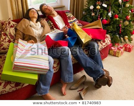 gelukkig · paar · vergadering · sofa · kerstboom · jonge - stockfoto © monkey_business