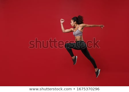 athlete jumps in length Stock photo © OleksandrO