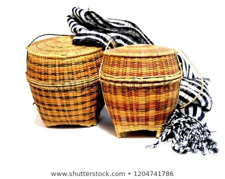 Colorful loincloth fabric on rattan basket Stock photo © yanukit