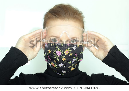 safety goggles and cotton gloves stock photo © dezign56