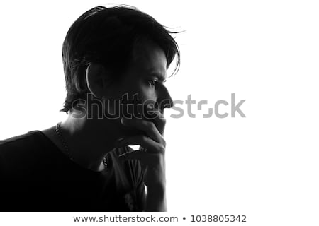 closeup portrait of a thoughtful man black and white photo stock photo © deandrobot