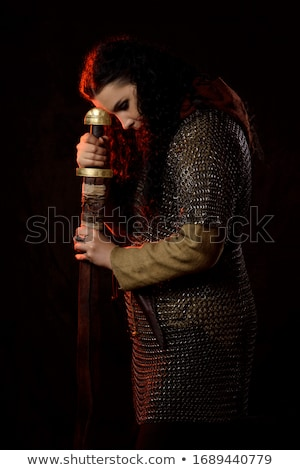 Knight with axe against dark background Stock photo © Elnur