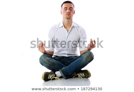 Man in casual cloth sitting in the lotus position over white background Stock photo © deandrobot
