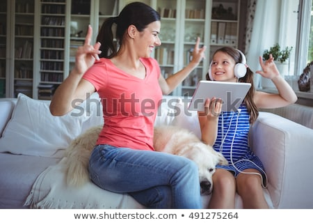 mother and daughter with pet labrador stock photo © wavebreak_media