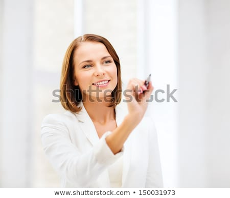 Pretty young teacher woman writing on the screen Stock photo © nenetus