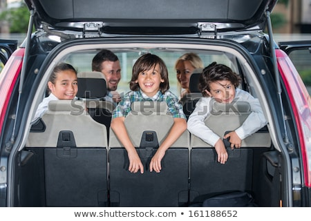 Smiling family in the car looking backwards Stock photo © zurijeta