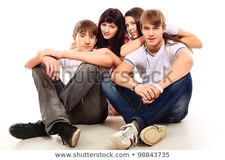 Four modern teenagers sitting Stock photo © zurijeta
