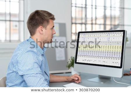 Businessman working on a statistical chart Stock photo © Kzenon