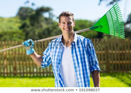 Férfi tart gereblye bajusz fehér fa Stock fotó © bluering